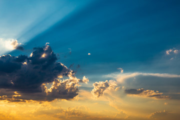 Dramatic blue sky with clouds and rays of sun, atmosphere cloudscape background