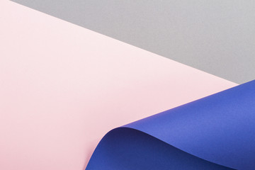 Abstract geometric shape gray, pink and blue color paper background