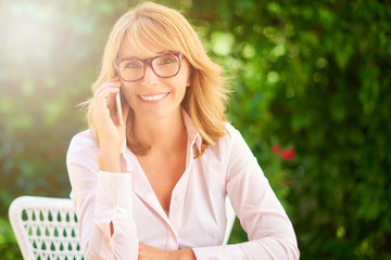 Happy confident woman making call