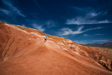 Woman with her son in valley of Mars landscapes in the Altai Mountains, Kyzyl Chin, Siberia, Russia