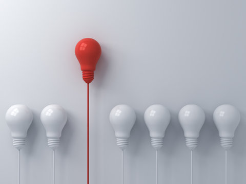 Think different concept One red light bulb standing out from the dim white light bulbs on white wall background with shadows leadership and individuality creative idea concepts 3D rendering