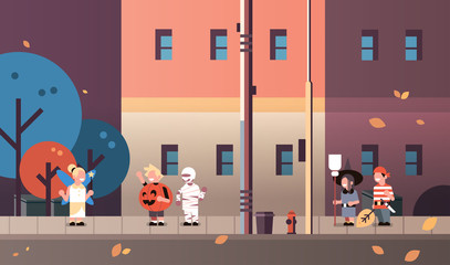 kids wearing monsters fairy pumpkin pirate mummy witch costumes walking town holiday concept tricks or treat happy halloween cartoon character full length horizontal flat vector illustration