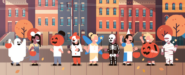 kids wearing monsters costumes walking town home buildings front view holiday concept tricks or treat happy halloween cartoon character full length horizontal banner flat vector illustration