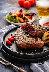 Steak - grilled beef steak. Fillet steak beef meat with  fresh salad, cherry tomatoes  and red pepper