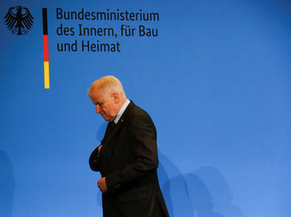 German Interior Minister Horst Seehofer leaves a news conference after adressing the media in Berlin