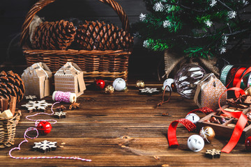 Seasonal and holidays concept. Christmas decorations and sweets on wooden board with place for copy space.