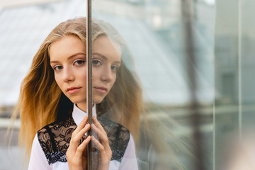 Portrait of beautiful girl and glass reflection