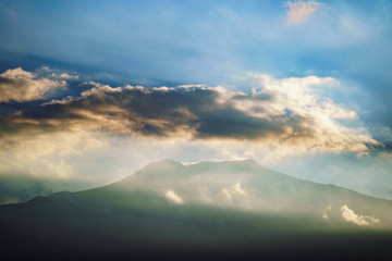 Etna volcano with clouds surrounding the mountain top