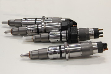 Car parts, service, diagnostics and repair of motor fuel equipment - diesel injectors of injection engines on white background