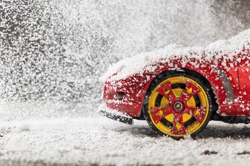 Red sports car in snow, christmas concept. Copy space