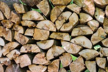 Large woodpile of firewood.