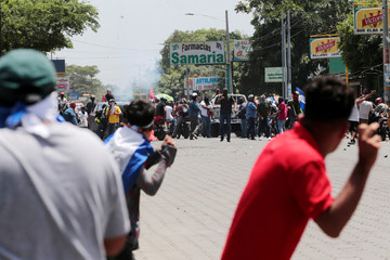 Demonstrators clash with supporters of Nicaraguan president Daniel Ortega's government in Managua