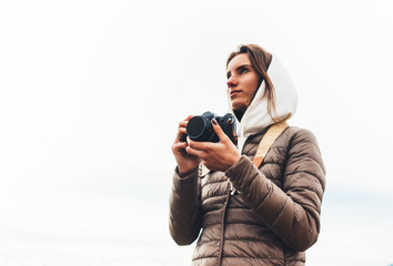 professional photographer tourist traveler standing on on a white background holding in hands digital photo camera, hiker taking photography, closeup girl enjoy relax holiday hobby concept