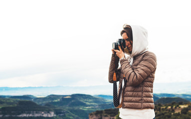 photographer traveler on green top on mountain, tourist holding in hands digital photo camera, click photography, girl enjoy nature panoramic landscape in trip, relax holiday hobby concept