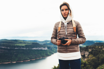 photographer traveler on top mountain, tourist looking enjoy nature panoramic landscape in trip, girl holding in hands digital photo camera, hiker taking click photography, relax holiday hobby concept