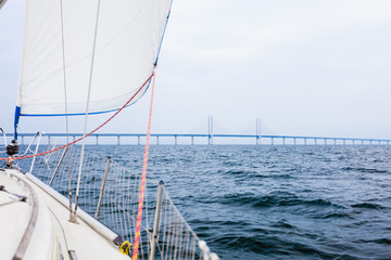 Yacht and oresund bridge between denmark sweden