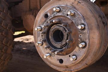 Maintenance a truck wheels hub and bearing .Rear wheels hub and bolt nut of a truck in process of changing wheel.  brake disc under repair