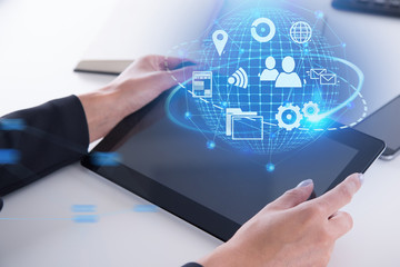 Global network icons on tablet, woman hands
