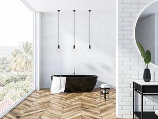 White brick loft bathroom, black tub