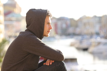 Teen boy contemplating a port on vacation Wall mural