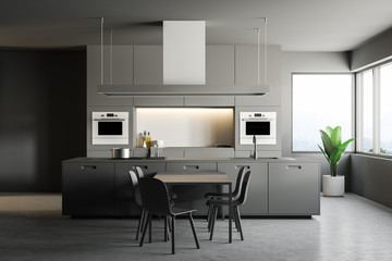 Gray modern kitchen interior, table and chairs