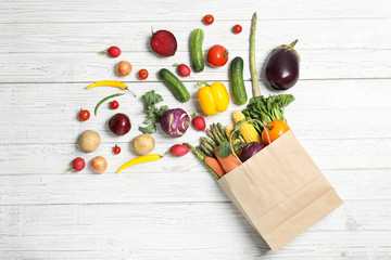 Flat lay composition with fresh vegetables on wooden background