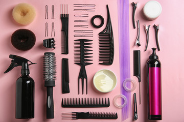 Flat lay composition with hair salon equipment on color background