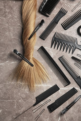 Flat lay composition with hair salon tools on grey background