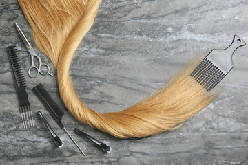 Flat lay composition with hair salon tools and space for text on grey background