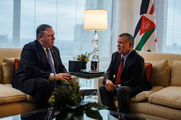 U.S. Secretary of State Mike Pompeo, left, talks to Jordan's King Abdullah II bin Al-Hussein, right, during a meeting at Mandarin Oriental Hotel,Êin New York