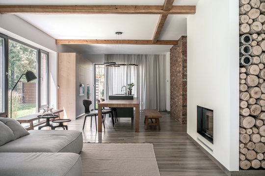 Stylish interior in modern style with wooden beams
