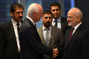 Iraqi Minister of Foreign Affairs Ibrahim al-Jaafari (R) shakes hands with UN Special Envoy of the Secretary-General for Syria Staffan de Mistura ahead of the United Nations General Assembly