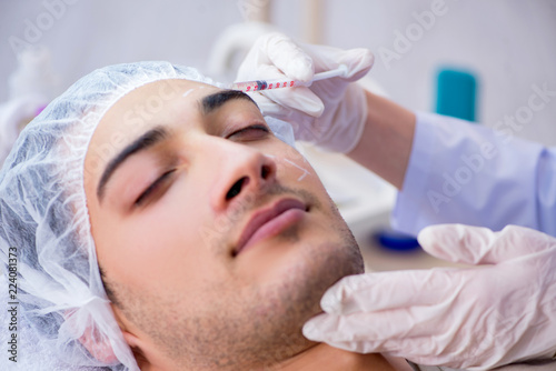 Man visiting doctor for plastic surgery