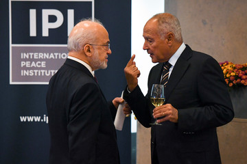 Arab League Secretary General Ahmed Aboul Gheit speaks with Iraqi Foreign Minister Ibrahim al-Jaafari during the International Peace Institute's Annual Ministerial Dinner on the Middle East in New York
