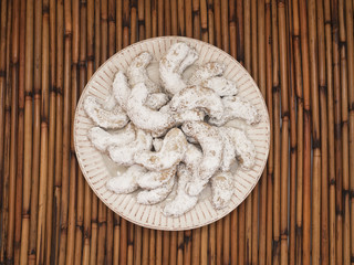 Crescent Cookies with Powdered Sugar OH, Beige on Bamboo