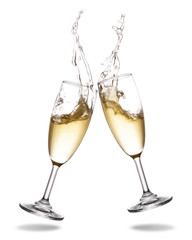 Cheers champagne with splashing out of glass isolated on white background.