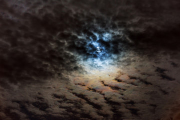 Mysterious night sky with full moon. Dramatic clouds in the moonlight from full moon.