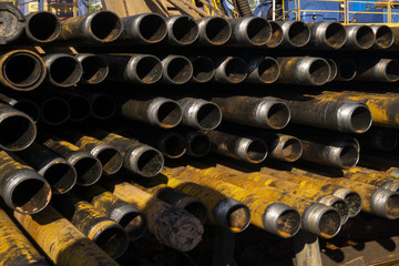 Drilling of oil and gas wells. Drill pipe inspection. Tubing for oil and gas listed on the pedestal out of the wells after washing and ready for inspection. Stack of casing laying on the deck