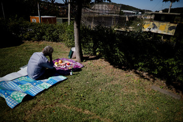 Ju Young-bok, a North Korean defector living in South Korea, cries during a memorial service for his North Korean family members, in front of a barbed-wire fence near the demilitarized zone separating the two Koreas, in Paju