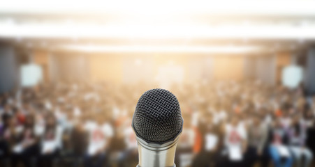 Microphone over the Abstract blurred photo of conference hall or seminar room with attendee background,Small Business training concept,Public speaking Fototapete