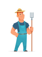 Farmer standing and holding agricultural tool or farm fork.
