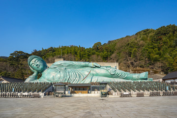 Wall Mural - Nanzo-in temple in Fukuoka, Japan with the largest bronze reclining buddha statue in the world