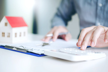 Business man calculated cost and  sign agreement contract, Insurance Home concept