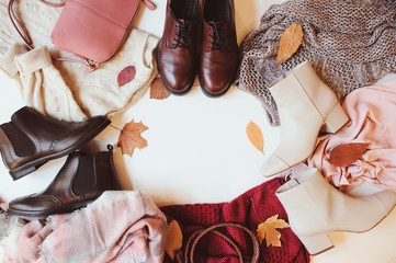 set of seasonal autumn fashion woman clothes, top view with copy space. Trendy shoes, sweater and handbag. Wall mural