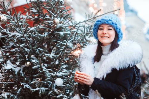 66f990f8b0f0 christmas portrait of happy woman with burning firelight walking ...