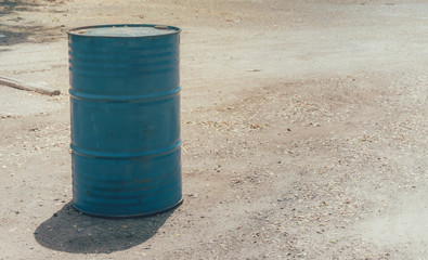 the blue steel tank on the ground for keep water or oil. with copy space for text.