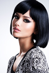 Beautiful woman with black straight hairs.