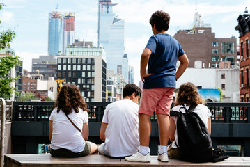 Young people sitting on High Line in New York