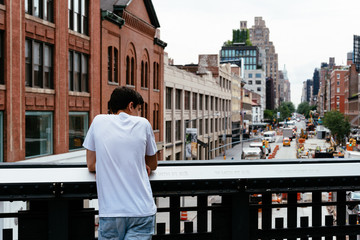 Young man looking at New York cityscape