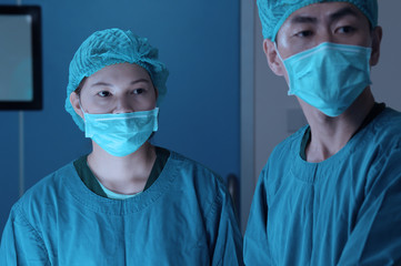 two of veterinarian surgery in operation room take with art lighting and blue filter